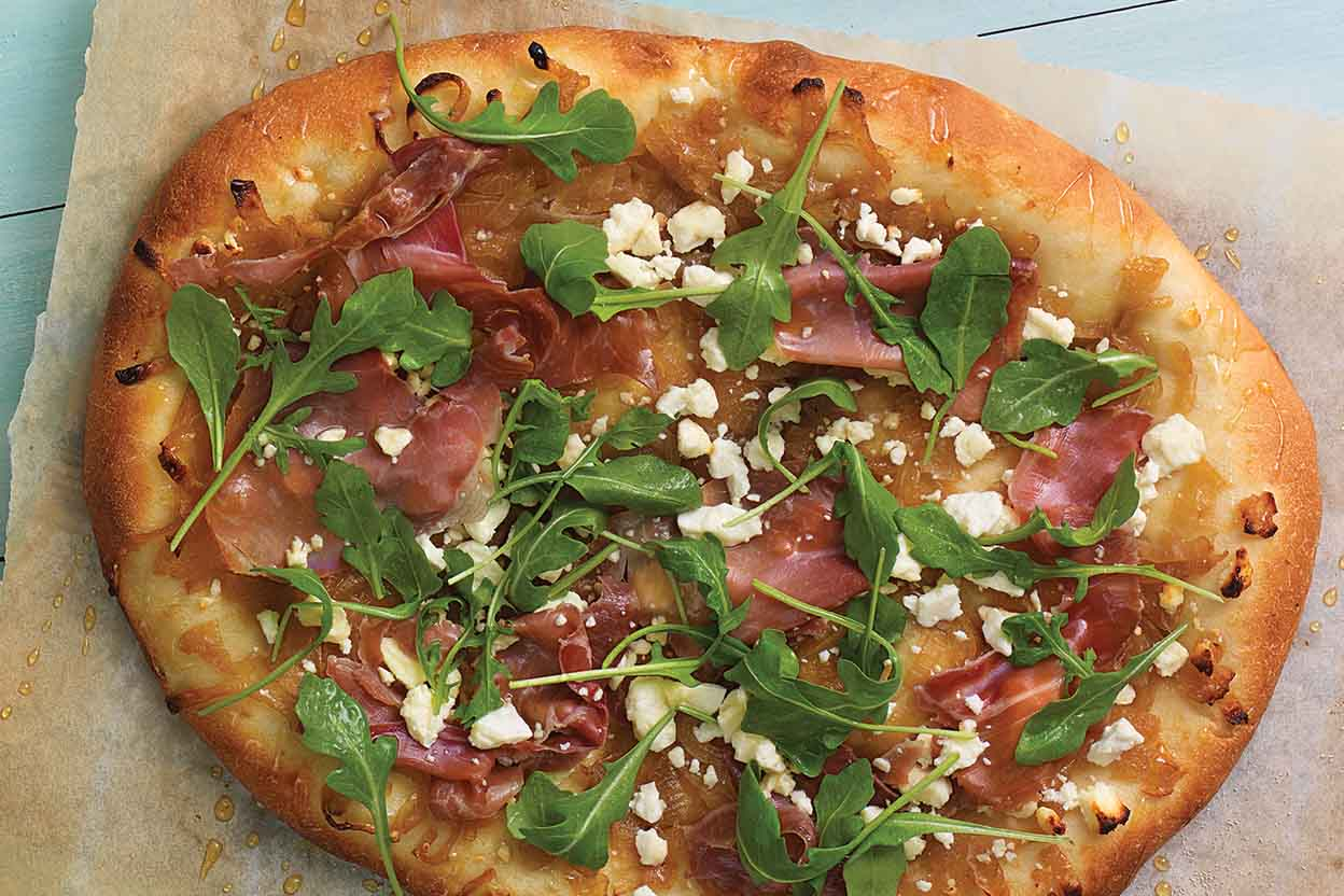 Spicy Honey Caramelized Onion Pizza with Prosciutto, Feta, and